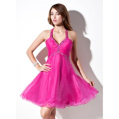 A-Line/Princess Halter Knee-Length Organza Homecoming Dress With Ruffle Beading