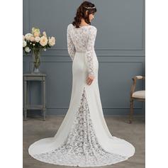 Forme Sirène/Trompette Col V Traîne moyenne Charmeuse Robe de mariée avec Brodé