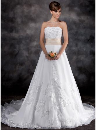 A-Line/Princess Strapless Chapel Train Organza Wedding Dress With Lace Sash Beading
